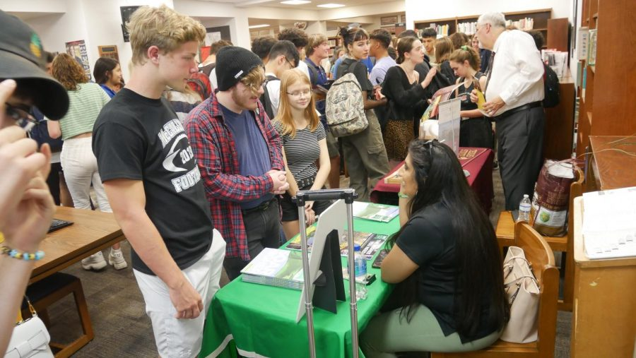 Juniors and seniors crammed into the library for a college fair on campus on Sept. 4, 2019. This is just one of the many college-application rites that have been fundamentally altered by the pandemic. Face-to-face counseling from admissions officers and even school counselors has become a thing of the past in 2020. Photo by Javier Vela.