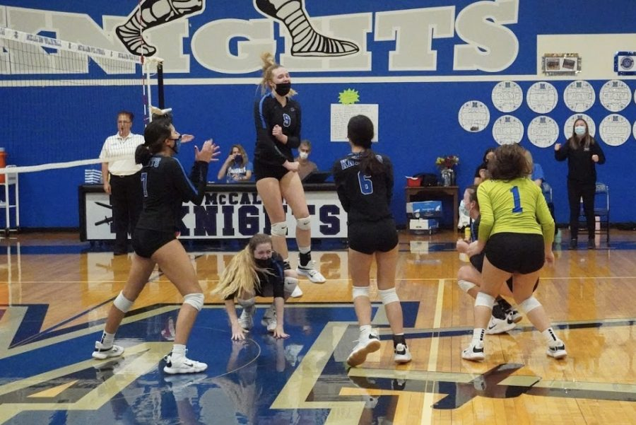 "The varsity players on the court at game's end leap into the air, shouting and smiling after they had just won their last home game of the season. The score was 14-10 in the tiebreaker set against undefeated Ann Richards. Junior Grace Werkenthin tipped the ball onto the other side of the net, propelling the team to a 3-2 victory. ""It was really exciting to final win that last set,"