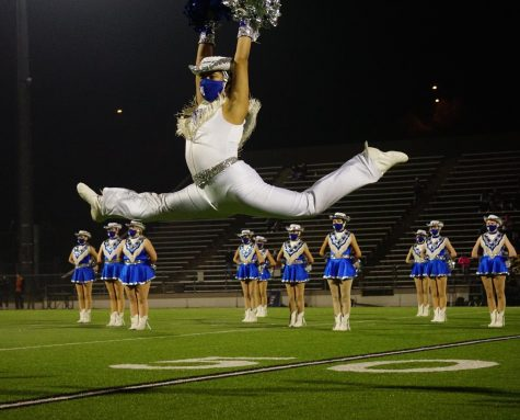 "Senior Blue Brigade co-captain Matthew Vargas leaps during the Dec. 11 halftime show, a field pom dance to ""Edge of Glory."" The game turned out to be the end of the Knights"