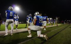 "Senior lineman Charlie Pecina kneels, taking in his last few moments on the field at House Park as a McCallum football player. Pecina said the team was optimistic heading into Friday's bi-district playoff game. ""Going into the game I knew we had to win or else it would be my last game in a McCallum jersey, but I felt confident because the coaches and the team felt like we had a good week of practice."" The game was a tough one as the Knights lost several players to injury or penalties. Despite the attrition, Pecina said he and his teammates left all they had on the field. Pecina made one of the game's best plays for the home team, a first-quarter interception the extinguished a Patriot scoring threat. ""Things didn't go our way with calls and injuries, but that doesn't matter. We still played our game and still put the most effort we could into the game."" Although the game was a loss, Pecina focused on the progress he, and his teammates have made. ""Even though we lost I was proud of how far we came from only winning one game our freshman year to having a winning season and making the playoffs."""