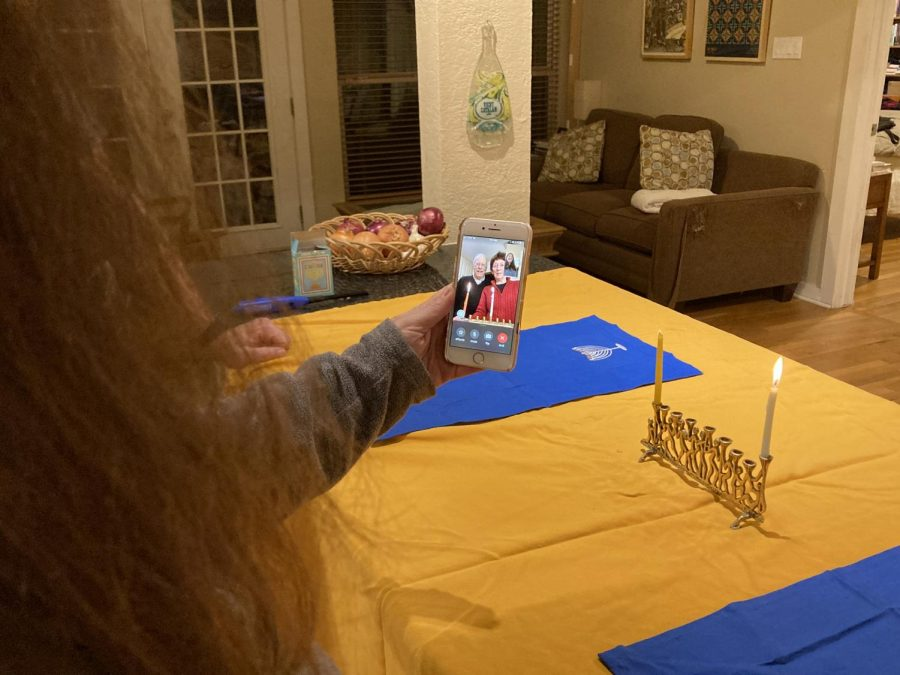 "FESTIVE FACETIME- After reciting the Hanukkah prayers and lighting her menorah the first night of Hanukkah, Carolyn Schwarz talks with her parents, John and Rhoda Schwarz over Facetime. Usually the Schwarzes would gather in-person to celebrate Hanukkah, but due to the safety concerns of coronavirus they decided to take part in the festivities virtually this year. ""Having older parents and knowing the health risks the virus could have on them made our holiday plans very clear"" Carolyn said. ""We knew that physically getting together would not be a safe option this year."" Carolyn celebrated the holiday at home with her husband and children while her parents celebrated with their dog, Winston. ""So much is different this year,"" Rhoda said. ""It is a blessing that we can still celebrate with each other in some way."""