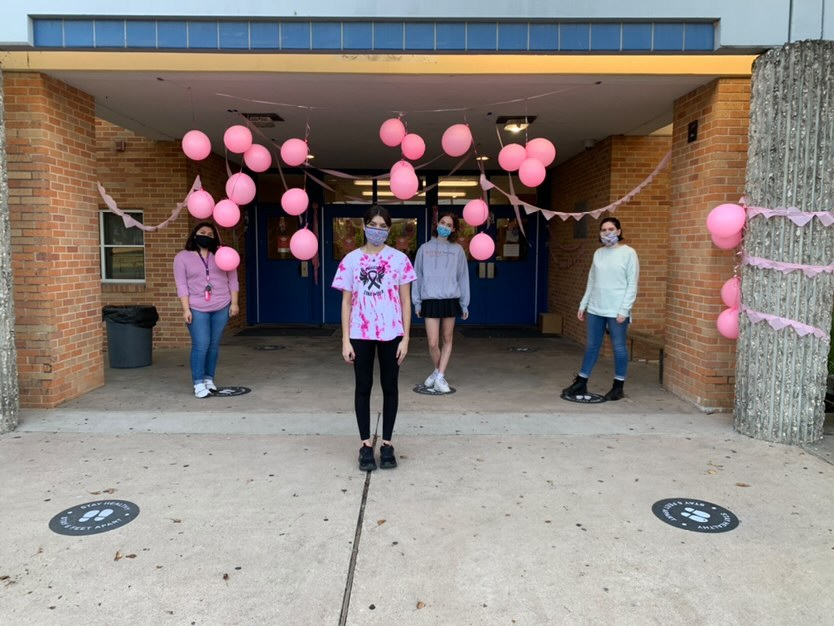 13 ACROSS: OCT. 25--Balloons and streamers adorn the campus as the tickled pink _________ program kicks off Mac's pep-filled Pink Week by decorating the school.