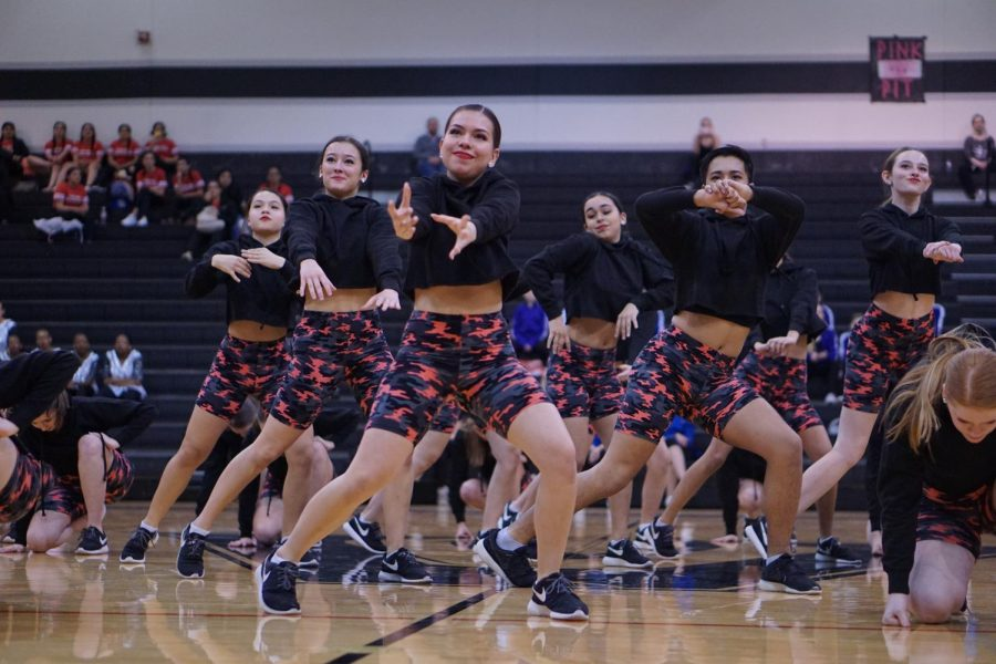 "Senior Valentina Paredes performs a hip hop routine with the Blue Brigade at the Austin Dance Classic in February 2020. Valentina says that between the two sisters, Andrea has an eye for contemporary dance and Valentina is stronger at hip-hop routines like the one she is performing. ""Andrea has done a great job choreographing more contemporary routines,"" Valentina said."