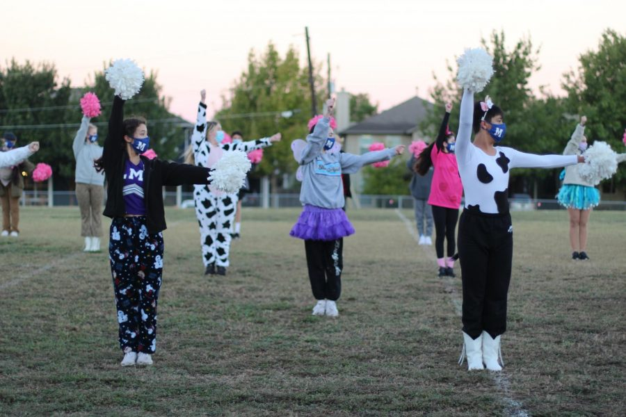 Decked out in costumes to celebrate Halloween, Blue Brigade co-captains Addie Seckar-Martinez and Matthew Vargas led the Brigade in practice on the football field on Oct. 29. Later in the season, the Brigade practiced on the tennis courts as well.