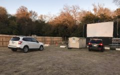 Pulling in, cars begin to park in preparation for a movie showing at the The Blue Starlite Drive Ins Mueller location in East Austin. The theater functions with five movie screens -- three for drive in and two for walk in -- that allow for multiple showings throughout the night.