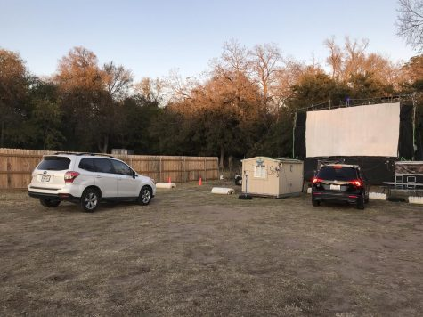Pulling in, cars begin to park in preparation for a movie showing at the The Blue Starlite Drive In