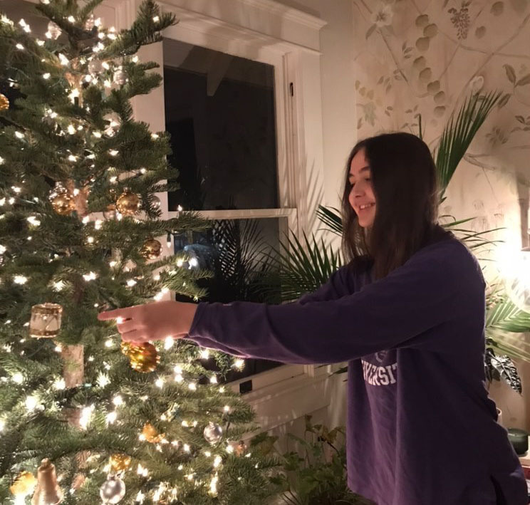 Naomi Di-Capua follows her family's traditional Christmas tree decorating strategies, despite not being able to celebrate with extended relatives. Her family opted out of group celebration this year due to the pandemic.