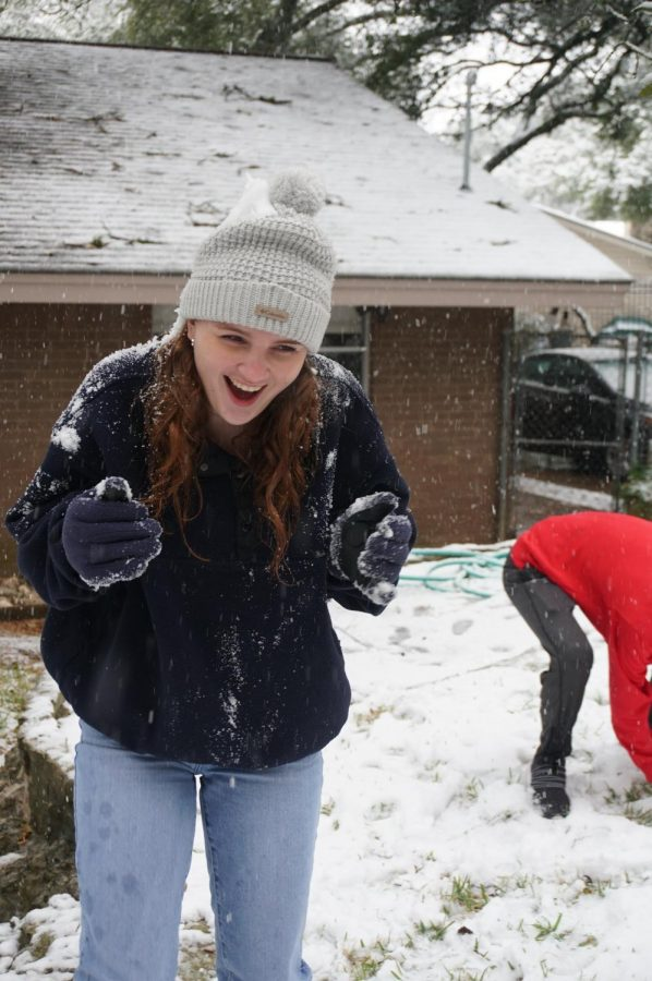 WINTER WONDERLAND INDEED: Junior Annabel Winter reacts to being ambushed with an avalanche of snow supplied by her older brother Henry, a 2020 Mac graduate. Winter said the best moment of her snow day was pegging her dad in the face with a snowball.