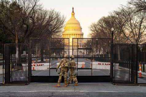 U.S National Guard troops stationed at the entrance to the U.S. Capitol on Wednesday, the same day the House voted to impeach President Trump a second time on the charge that he incited the insurrection that occurred at the Capitol the week before. National Guard troops will be stationed at the Capitol at least until Biden's inauguration. Photo accessed on Geoff Livingston's Flickr account. Photo reprinted with permission under a creative commons license.