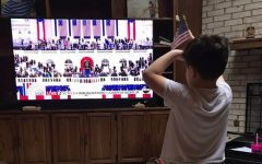 Watching the inauguration from his home on Jan. 20, Alpha Noack, 7, the son of science teacher Sarah Noack, waves his flag and pretends to take the vice presidential oath along with Kamala Harris.