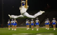 """Senior Blue Brigade co-captain Matthew Vargas leaps during the Dec. 11 halftime show, a field pom dance to """"Edge of Glory."""" The game turned out to be the end of the Knights' season, and the last time the Blue Brigade seniors would perform at halftime of a high school football game. """"I was really excited and optimistic,"""" Vargas said of his feelings before Friday's game. """"The sunset was so pretty and it just set the mood and I was happy."""" By halftime, the Knights' trailed by 21 points and the future looked bleak for the season, but Blue Brigade was still excited for its performance. """"I knew it would be the last performance, so I just wanted to give it my all, and honestly I have never felt so happy during a performance. Hitting that ending pose gave me the chills, and I had such a big smile under my mask."""""""