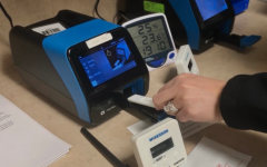"""THE PROCESS OF COVID TESTING: The routine process of testing for COVID is a technique that the ER technician has perfected. """"After scanning in the patient's information into the Sofia, you get reagent tubes and use a bit of solution inside and mix it with your swab,"""