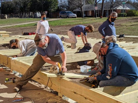 THE FINAL STAGES: The community construction crew the raised a stage this past weekend included faculty members like math teacher Matt Whipple left and interim principal Nicole Griffith (standing at right). Photo by Sarah Noack.