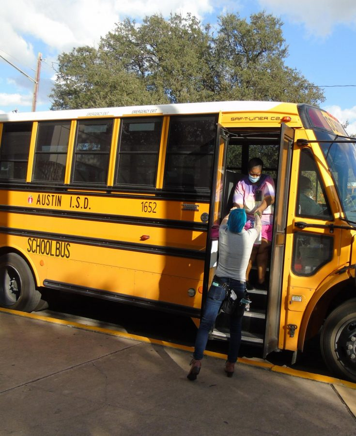 Teacher Megan Susong delivers gift bags to the afternoon bus drivers after school in the circle drive as part of the Maculty's effort to show its appreciation for the @austinisd transportation team on Oct. 22.