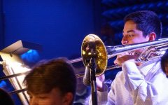 Senior Jacob Martinez stands to perform a trombone solo at downtown Parker Jazz Club alongside fellow McCallum Jazz Ensemble musicians. In addition to earning TMEA All-State recognition in the concert band competition, Martinez earned a state spot in jazz as of last semester.