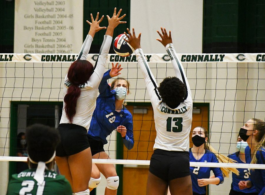 Senior Shield co-editor in chief Bella Russo was one of three MacJournalists to win a Sweepstakes Award. She won in the Sports Action Photo category. About this photo:  GELLA, YES! Freshman middle hitter Gella Andrew spikes the ball into the Cougar block for one of her six kills during the second set of the Knights' 3-1 bi-district playoff loss on Friday night. The Knights lost the set, 25-23, in heart-breaking fashion to fall behind, 2-0. The Knights rebounded to win the third set, 25-17, before losing the fourth set, 25-20, and the match, 3-1. Andrew was solid in the middle in the final game of her breakout freshman season. Her kill percentage was a team best 37.5 percent, and she had one of the Knights' four solo blocks for the match.