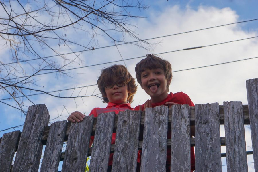 Jackson and Nate Baugh smile and act silly from their backyard playground after school — keeping recess going even after hours.