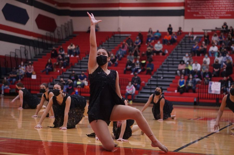 "FULL CIRCLE: For seniors like co-captain Addie Seckar-Martinez, shown here performing in the large ensemble contemporary dance for which the team won a Best in Class award, the site of the Central Texas Dance Festival at Georgetown's East View High School offered an opportunity to come full circle.  East View was the site of the first competition the seniors entered as freshman four years ago. ""We have had a lot of events get canceled this year due to COVID and weather inconveniences, but being able to be out there dancing to an audience with my Blue Brigade family meant so much to me,"" Seckar-Martinez said. ""I always tell the team to go out there and just have fun and that's exactly what we did."" Reporting by Zazie Bryant."
