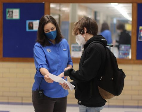 McCallum Interim Principal Nicole Griffith helps a first-day freshman on March 1, which felt like one of Griffith