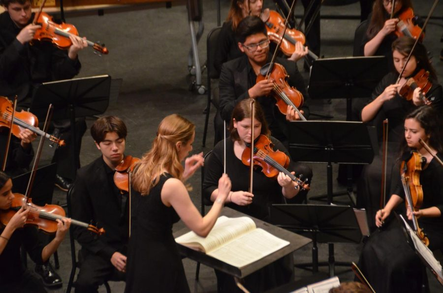 IN FULL SWING: At McCallum's joint orchestra, band and choir performance of Carmina Burana in 2019, Kashdan conducts a movement of the cantana. This show sits at the top of Kashdan's favorite Mac performance list.