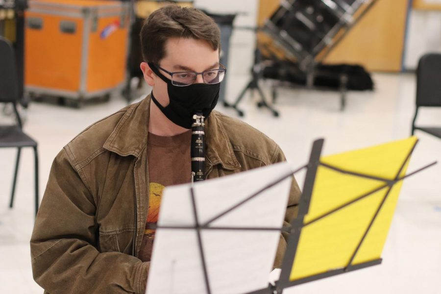 Senior Kyle Davis practices clarinet in the first in-person concert band rehearsal of the year on March 2. Despite getting some at-school practice, Davis still experienced the UIL Solo Contest from home. Davis played piano, one of the three instruments he plays.