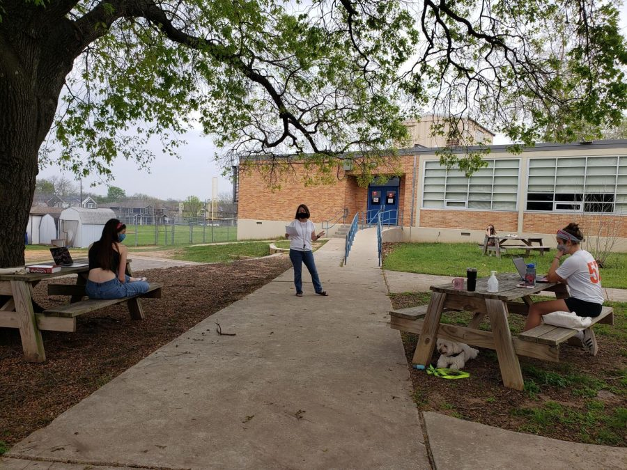 MacJournalism co-adviser Jena Weber reviews the instructions for news writing prior to that event at the UIL district meet held outside on the Mac campus on March 27. Due to COVID safety measures, each school met on its home campus, and the Shield staffers decided to hold theirs outside on the picnic tables to make the event even safer. Freshman Alice Scott (center) won first place in news writing. Juniors Samantha Powers (left) and Anna McClellan (right) finished second and fourth respectively.