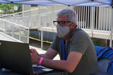"Language arts teacher Eric Wydeven ""attends"" a virtual department meeting on Tuesday. Even teacher gatherings have had to move to Zoom during the pandemic that has now stretched beyond a year and left many teachers, like their students, feeling isolated and alone."