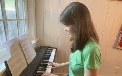 Junior Veronica Britton practices her solo,