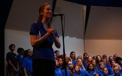 THANK YOU AND GOOD NIGHT: McCallum Choir Director Allison Kashdan thanks parents and community members for attending the 2019 Fall Choir Concert — a pre-Covid performance showcasing female composers. Now a new mother, Kashdan will not return to McCallum next school year due to safety concerns.
