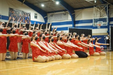 "STICKING WITH TRADITION: The McCallum Blue Brigade sticks the final pose during ""Last Dance"" to conclude their first Spring Show of 2021 on Friday April 16. ""My favorite dance is 'Last Dance' because it"
