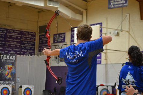 """FROM THE BEGINNING: Freshman Milo Conner (shown here) and freshman Sophie Leung-Lieu are the only two archers in Coach DeLine's program to competitively shoot in teams from three schools. In 2017, they shot at Highland Park; from 2018-2020. at Lamar; and now, they are shooting as part of the McCallum team. """"It's a great community with lots of support from our coach,"""" Conner said, adding that he plans to continue archery during his three remaining years of high school. Reporting by Leung-Lieu."""