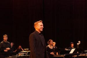 Ehlers smiles at the conclusion of the December 2019 send-off concert for the Midwest Clinic in Chicago, which the percussion section would attend later that month.