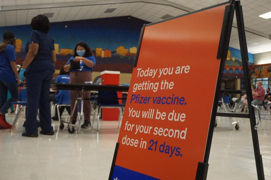 From 3:30 until 8 p.m., today, the McCallum cafeteria was the site of a vaccine clinic for anyone 12 years or older. The clinic was sponsored by the Austin Latino Coalition and the U.S. Hispanic Contractors Association. The clinic delivered first-dose Pfizer vaccine shots to 383 arms.