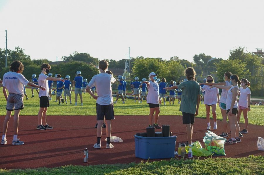 In what turned out to be her last first day of practice as the cross country coach, Susan Ashton huddles up the COVID-safe way with her runners on Sept. 7, 2020.