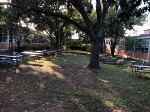 For the second stage of the project, six parents and four students cleaned up the courtyard between the science labs and the foreign language hall and added 10 more picnic tables. They also added 10 Adirondack chairs in front of the main building.