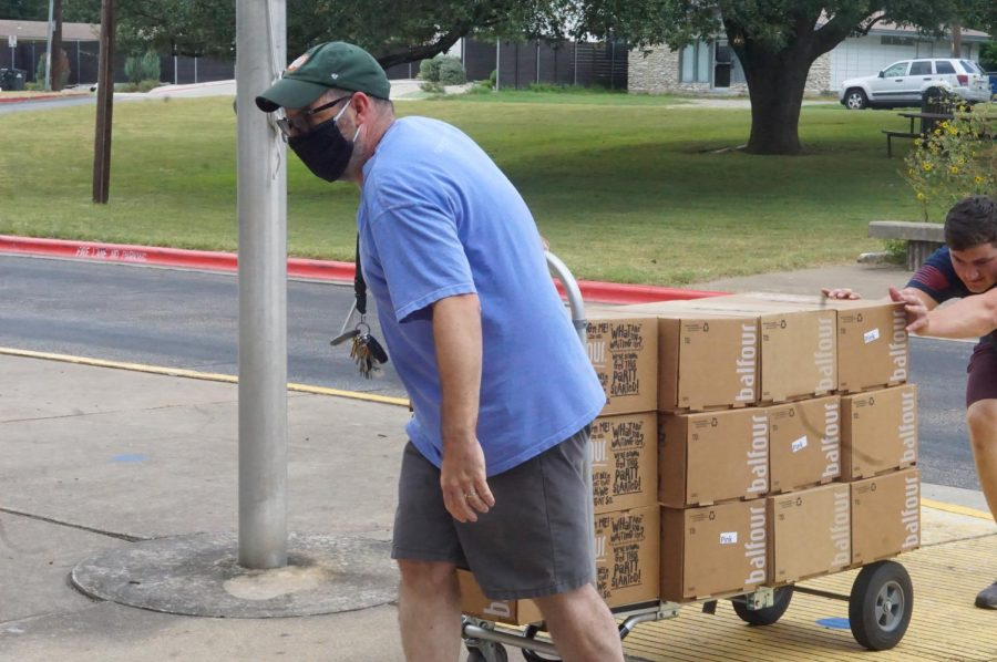 Co-adviser+David+Winter+helps+unload+the+yearbooks+on+campus+today.+Distribution+will+be+held+on+Monday%2C+Aug.+9.+
