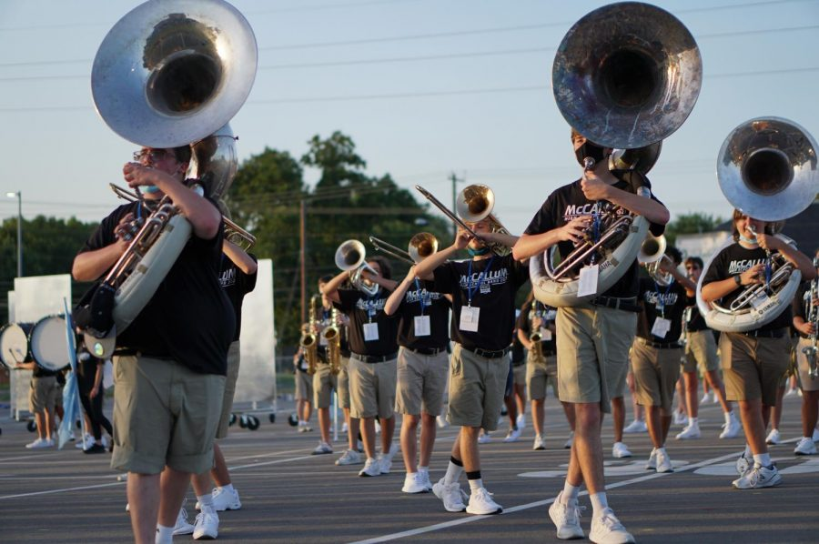 """SENIOR SALUTE: In the marching band's first performance back from a virtual year, senior Kaden Davis leads a diagonal line in one of the marching band's sets. The change from online to in-person was real for Davis, as he describes his emotions leading up to the show: """"My nerves definitely kicked in at first,"""" he said. """"But once I got to my set position and the show began, my confidence went through the roof and I felt so proud."""" Despite it being different from previous year's Bandapaloozas, Davis felt it was a great way to start the season. He shares, """"Not having a marching season last year really took a toll on all of us, especially the class of '21. So I know that all the class of '22 seniors are extremely grateful to even have a show this year."""" Reporting by Lydia Reedy. Photo by Eliza Jensen."""