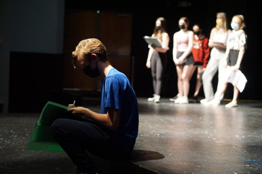Junior Anderson Zoll makes some notations on his copy of the script for SpongeBob the Musical this afternoon in the Fine Arts Building Theater.  After two performances on the outdoor stage in 2020, MacTheatre will take its next musical production back to the MAC.