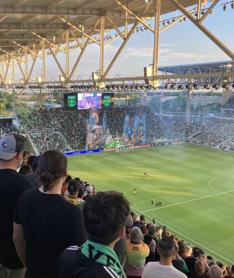 Amid smoke from a pyrotechnic display at Austin FC's first home game, the tifo looms large on the south end of the stadium. Rising sophomore Sam Dueñas-Lujan, who helped paint the tifo, was also on the team that raised it on game day.