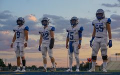 CAPTAINS AT TWILIGHT: Seniors Ez Guenther, Jake Hissey, Jaxon Rosales and Johan Holmes lineup for the coin toss before their last non-district game against the Kerrville Tivy Antlers. For Hissey, it was his first game back after suffering a wrist injury before the team's marquee matchup against the Anderson Trojans. Despite wearing a cast that prompted the opposing coaches to urge their offensive skill players to run at the one-armed safety, Hissey held his own, nearly making an interception to seal the victory on the play before Guenther succeeded in doing the same. The Knights went on to beat Tivy 23-15 in a game that despite Tivy's 0-4 record, they were not favored to win. Caption by Thomas Melina Raab.