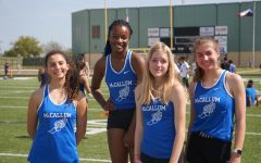 At the Austin Relays at Burger Stadium on March 12, 2020, one day before COVID-19 was first detected in Austin, Kendall Shenoda, Caytie Brown, Stella Davidson, and Zoe Tanner relax between their scheduled events. Tanner launched a petition drive to create a track class at Mac. In addition to making the sport safer and more competitive, Tanner believes it will improve an already strong sense of community among the athletes on the team.