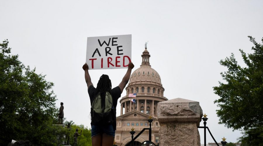 WE ARE TIRED (May 31): On a day when hundreds of protesters gathered in downtown Austin during the second day of demonstrations against police brutality in the aftermath of the deaths of George Floyd and Mike Ramos, a solitary protester holds a sign with a simple message seemingly directed at the Texas Capitol and the government that convenes there.
