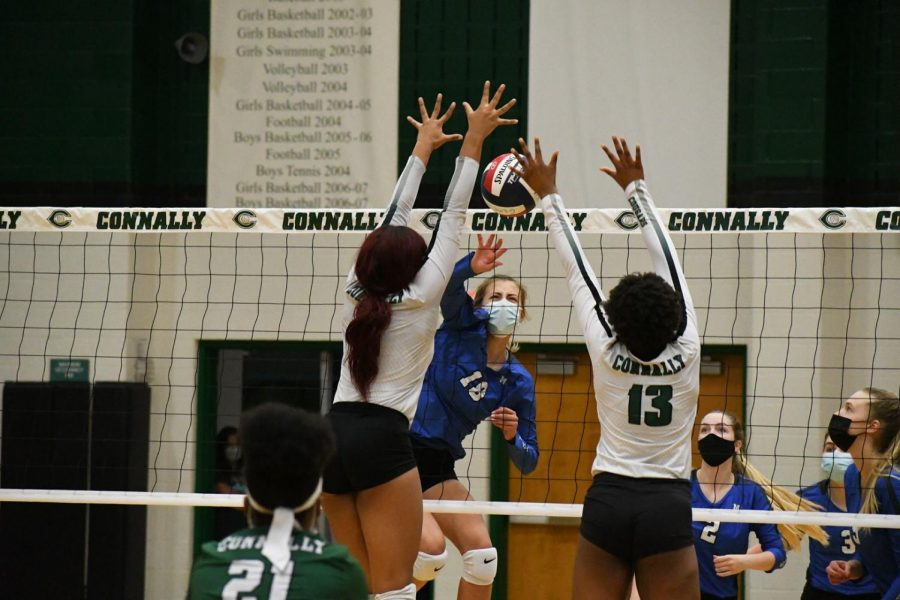 GELLA, YES! Freshman middle hitter Gella Andrew spikes the ball into the Cougar block for one of her six kills during the second set of the Knights' 3-1 bi-district playoff loss on Friday night. The Knights lost the set, 25-23, in heart-breaking fashion to fall behind, 2-0. The Knights rebounded to win the third set, 25-17, before losing the fourth set, 25-20, and the match, 3-1. Andrew was solid in the middle in the final game of her breakout freshman season. Her kill percentage was a team best 37.5 percent, and she had one of the Knights' four solo blocks for the match.