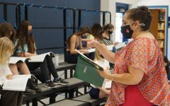 Ms. Rodriguez conducts her first-period choir class on Aug. 23. A 30-year veteran who has taught in Corpus Christi, Bastrop, Pflugerville and most recently at Akins High School, Rodriguez says she was drawn to the Fine Arts Academy because of the caliber of students it attracts.