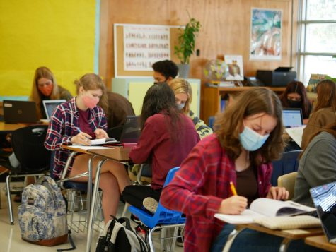 French 3 students work independently on vocabulary practice during class time. With Favrin busy instructing French 4 and 5 students, they must manage their time and assignments and continue to develop their French skills on their own.