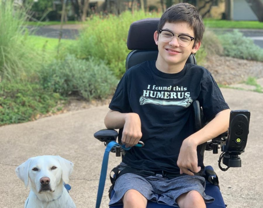 Freshman Ben Polega poses with his service dog Friday for a first-day-of-school photo.