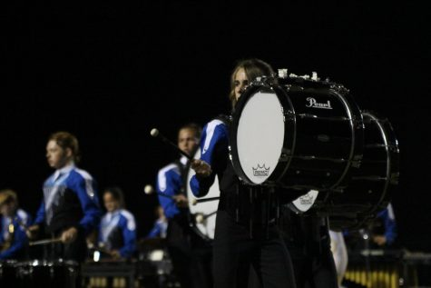 Freshman Jake Stagg-Ricketts plays bass drum at the Capital City Marching Festival.on Sept. 25 at Burger Stadium.  Photo by Morgan Eye.