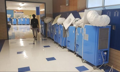 The portable air-conditions that had been cooling classrooms without functioning AC sit in the main hallway on the morning of Sept. 29. The short-term rental contract had expired at the units were picked up in the afternoon.