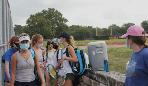The girls tennis team prepares for practice. Last year, due to COVID, the team could only conduct practices after school or on Saturdays, instead of during class time. COVID didnt influence it—COVID wrecked it, head coach Christopher Purkiss said.