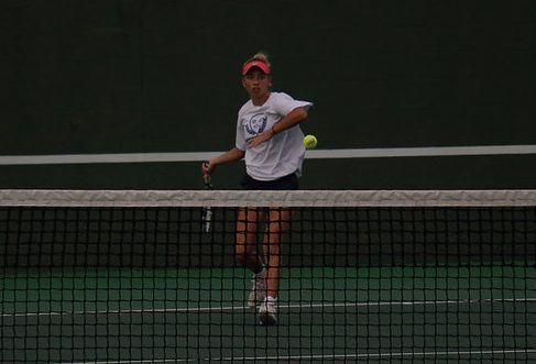 """Senior Peyton Casey hits the ball, in her final tie-breaking match. Caseys win led to McCallums win, 10-9 over Connally. """"It came down to Peyton and it was 9-9, and everyone realized that this is the match to determine who wins the whole thing,"""" Coach Purkiss said. """"So everybody was there and their team was on their side and our team was on our side and we were cheering Peyton on every great play that she made so it was great to support her and see her play her best."""""""